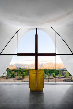 """Steyn Studio, working in collaboration with South African firm designed this striking architectural project for the Bosjes Canopy Chapel in South Africa. """"The chapel… Sacred Architecture, Architecture Cool, Religious Architecture, Contemporary Architecture, Glass Structure, Concrete Structure, Monuments, Architecture Religieuse, Glazed Walls"""