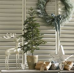 Nice cohesive look with this collection of Christmas items.—love everything. Juniper Tree in a Glazed Pot | Natural Calico