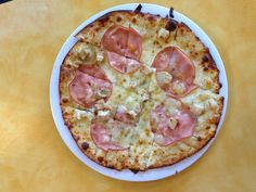 Solos Pizza Cafe's Bleu Moon pizza is topped with olive oil, Canadian bacon, grilled chicken and Gorgonzola cheese. Yum!