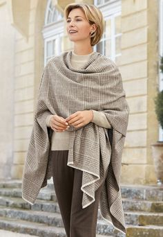Italian woven check serape | £59 | This sumptuous limited edition Italian serape, made with a soft cotton-blend yarn, features a two-tone Prince of Wales check design in elegant, neutral shades. Finished with tiny fringed ends.