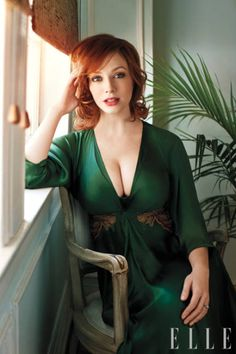 Famous Actress Christina Hendricks As Mad Men Tv Show Famous Office Manager Joan Holloway.