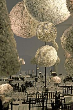 A stylized garden of sculpted topiary created from 6000 lbs of shredded office waste.