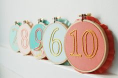 handmade wedding table numbers embroidery hoops by the merriweather council (etsy) via emmalinebride.com