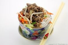 """Bún thịt bò xào xả ớt (chile lemongrass beef noodles) is one of my favorite Vietnamese """"casual"""" everyday meals. I like the way lemongrass is used to spice things up in this Vietnamese classic. Tender, boneless stir-fried beef is cooked with fresh lemongrass, freshly chopped chile peppers and onions. The meat is served in a bowl filled with cold vermicelli rice noodles, roasted peanuts, fresh vegetables (usually cucumber and pickled carrots), fresh Vietnamese herbs and soy bean sprouts. The…"""