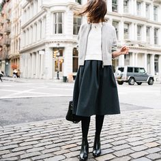 noticed / comfy, cozy layers: feeling pajamas, looking polished, today on the blog (link in bio)  ps, that's our pleated ponte midi skirt, bomber cardigan, off-duty sweatshirt, the ames boot, and a #madewellxsezane nola satchel