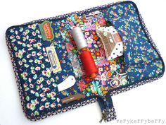 Sewing organizer with a zipper (like a huge zip around wallet) tutorial by Kerry Green on the LIberty Craft Blog.