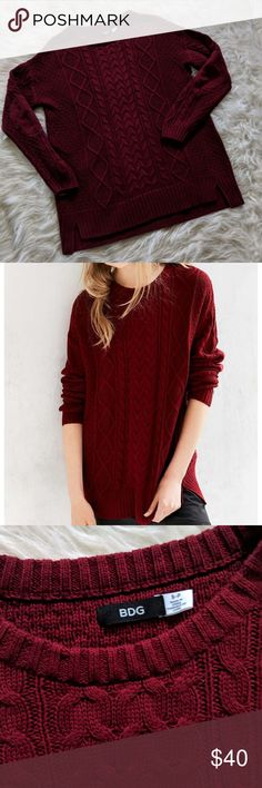Urban Outfitters // BDG Sweater Beautiful deep red oversized cable knit sweater from BDG // Urban Outfitters. 60% cotton and 40% acrylic. Size small.  Measurements-- Pit to pit: 22.5 in. Length: 28.5 in. Sleeves: 21 in. Urban Outfitters Sweaters