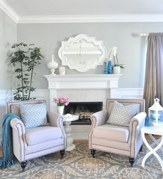 beautiful living room. love the studded chairs, patterned carpet and pillows