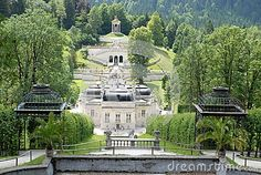 Photo made in Linderhof in Bavaria (Germany). In the photo, made from large gazebo that sits high in the back of the castle of King Ludwig II of Bavaria, you can enjoy the whole panorama of the building and part of the garden. At the bottom of the image you see the temple which is in green hill opposite the castle.