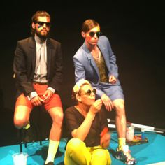 Designer sits with her models to blow bubbles at the Andy Wolf Eyewear/Superated show S/S 2013