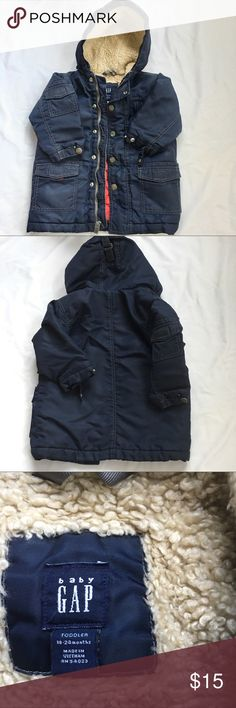 Toddler Gap Parka This parka is in good used condition. There's a Pocket on the right arm as well as on the inside. The last picture is the middle of the coat show light wear. It's like elastic poking out. (That's the best way I can describe it) there's no fading   PRICE FIRM gap Jackets & Coats