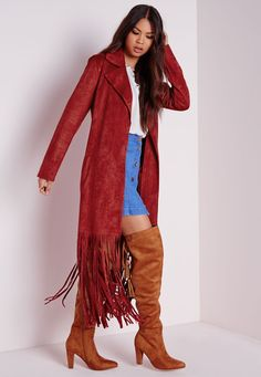 We're vibin all over this rust trench coat this season. In a chic faux suede fabric with totally on point tassel fringe finish to the hem and pocketgs to the hips this trench is the perfect throw-on-and-go. Team over flared jeans and whit...