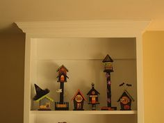 haunted village made out of bird houses, paint, scrapbook paper and a little bit of imagination!