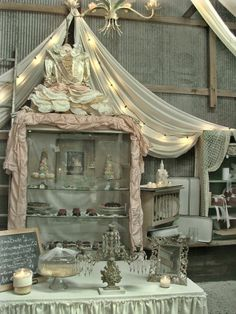 The most beautiful market stall/sweet table display!! I love the use of drapes.