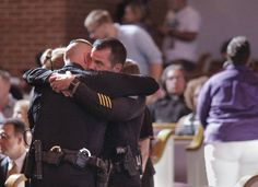 Chattanooga Deputy Police Chief David Roddy, right, hugs Sgt. Denny Jones before an interfaith vigil at Olivet Baptist Church held in remembrance of victims of the July, 16 shootings on Friday, July 17, 2015, in Chattanooga, Tenn. The vigil was held one day after gunman Mohammad Youssef Abdulazeez shot and killed four U.S. Marines and wounded two others and a Chattanooga police officer. Photo by Doug Strickland /Times Free Press