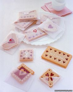 Loving the cookie in the bottom right corner. /// Valentine cookie envelopes made of wax-paper. Martha Stewart.