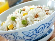 """Arroz à Grega. Rice with peas, corn, carrots, green pepper and egg. In most restaurants in Brazil you will be able to chose between white rice, arroz à Grega or arroz à piamontese to accompany your choice of meat. The same with potatoes (chips, crisps, boiled, sautéed or mash) and """"farofa"""" (simple, with banana or eggs)."""