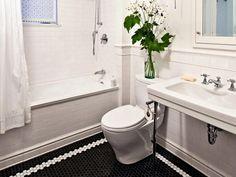 Black hex flooring w white hex border, via amber interiors blog