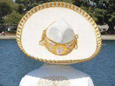 Authentic Mexican Charro Mariachi Sombrero  -Handcrafted in Mexico by experienced Hands -Made from Ivory/ White/ Black Suede -Gold/Silver Metallic Embroidery along sides and top of Sombrero -Adjustable Gold/Silver Metallic Sombrero Tie -Perfect for both Boys and Girls, Adult sizes