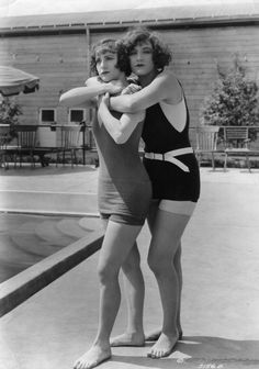 """Andrea Sayley and Margaret Oliver, two of slapstick comedian Mack Sennett's """"Bathing Beauties,"""" demonstrate how to save someone from drowning, circa 1917. Photo: Hulton Archive, Getty Images"""