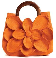 This is the Guadalupe bag by Mar Y sol (wooden handle & woven raffia), but should be easy enough to replicate with fabric or felt. (http://shopmarysol.com/shop.htm)