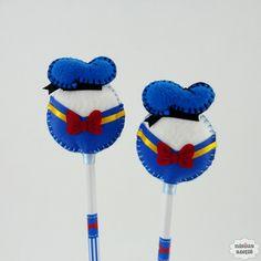 Ponteira de lápis ou caneta decorada com o Pato Donald feito em feltro bordado à mão. Quantidade mínima 10 unidades. Produto 100% artesanal.
