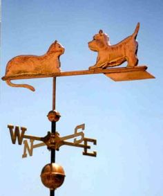 West Highland Terrier Dog, With Cat  by West Coast Weather Vanes.  This copper West Highland Terrier Dog weathervane features glass eyes, gold leafed patterns and distinctive tooling which gives the fur a realistic texture on the body.   Customers can provide photographs of their special canine pets for a customized weather vane depicting  their favorite dog.