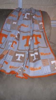 Beautiful Tennessee Volunteer fleece blanket with crocheted edges in orange. Blanket measures 56 x This would make a wonderful gift for that Tennessee fan in your life Ut Football, Football Crafts, Tennessee Football, University Of Tennessee, Tn Vols, Tennessee Girls, Orange Country, Tennessee Volunteers, Mom And Dad