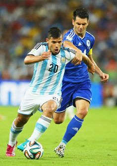 Sergio Aguero of Argentina fights off Emir Spahic of Bosnia and Herzegovina during the 2014 FIFA World Cup Brazil Group F match between Arge...