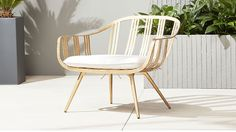 Shop gala gold lounge chair. Gilded seat gives guests the royal treatment indoors and out. Streamlined iron frame is cut, form and welded by hand, then finished in an oil-based golden glaze. Linen-like cushion ties on for a soft finish.