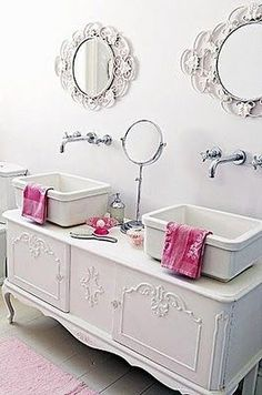 Great shape chic bathroom. I love the mirrors and vanity!
