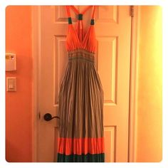 🛍SALE 🛍 NWOT sexy deep v-neck maxi dress New maxi dress in grey with orange and green accents. Plunging neckline,  built in bra cups, elastic waist and slight stretch for extra room. The material is light and thin (not see through) so it's perfect for the summer or beach. This dress will fit a 9/10 or 11/12 ✅Make me an offer I can't refuse 😄 ✅Bundle for more savings (15% on 2 or more items)  🚫No trades or lowballs 🚫 Dresses Maxi