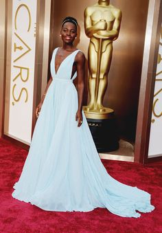Actress Lupita Nyong'o attends the #Oscars wearing a pale blue Prada gown. 86th Academy Awards - 2014 #RedCarpetReady #LupitaNyongo #TheLimited #2014