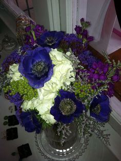 Blue, white, green and purple wedding bouquet with anemones, stock, brazilia, hydrangeas, limonium and statice
