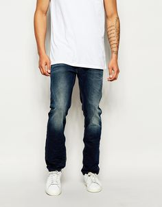 """Jeans by Diesel 12.25oz denim Mid-rise Concealed fly Slightly tapered leg Leg opening: 36cm/14"""" Slim fit - cut closely to the body Machine wash 100% Cotton Our model wears a 81cm/32"""" regular and is 188cm/6'2"""" tall"""