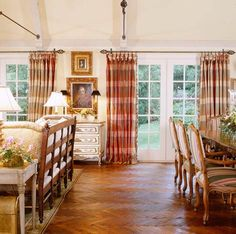 Interior Designer Charles Faudree:  French Flair~~Plaid draperies in the same colors as the striped dining chairs also pick up the color of the sofa upholstery, inking the dining and living areas.