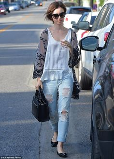 Laid-back chic: Lily Collins showcased her chic laid-back style when stepped out in West Hollywood in a sheer kimono top and ripped jeans, on Wednesday afternoon