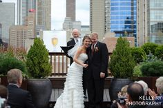 She's smiling because the Chicago view is so amazing from our rooftop garden.