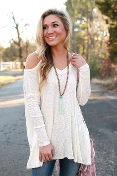Pairing this top with dark jeans and booties or wedges creates a winning look!