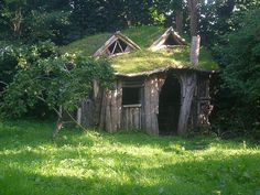 A Sod-covered Found-wood Playhouse In A Woody British Backyard