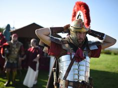 """Reenactors portraying soldiers from the Imperial Roman Army prepare for a battle with Caledonian barbarians during English Heritage's history weekend, """"Hadrians Wall Live"""", at Birdoswald Roman Fort near Gilsland, northern England on Sept. 6, 2015.   Oli Scarff, AFP/Getty Images"""