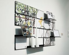This is really great.  It is wall art that folds down to a shelf.  It works well in a small city apartment.  The shelves are also magnetic so you chan change the art on your shelves.  Brilliant !  I like this idea for entertaining in a small space.