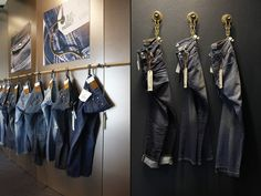 Sugarcity showrooms & office by vanbrussel, Halfweg, Netherlands store design. Interesting that these jeans look even more important and special NOT being folded or on hangers! PopUp Republic
