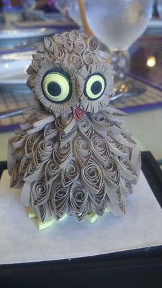 A 3D Quilled Creation: I made this baby owl out of scrap sheets of paper for my mother. It took a really long time to make because (hahaha) my dog kept eating the body. No joke. :D