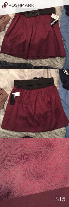 NWT Floral Skirt NWT!! Never warn. Has stretchy belt and a nice floral like pattern that is very subtle. Maroon color. Stooshy Skirts