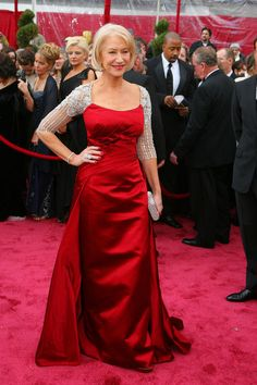 Helen Mirren at the 2008 Oscars. This red satin Georges Chakra dress was beautiful, but what made it stand out from the rest (and provide rare arm coverage) was the attached silver lace shrug.