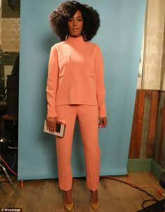 Solange Knowles oozes Sixties style in matching coral top and trousers #dailymail