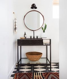 """AFTER // and here is the after! Bright and open and modernized! Crazy difference a little white paint, new floor and unique vanity will do! What do you think about """"before and after"""" pics??? Is this a fun game?? If so I'll make it a habit  I tagged sources above. #ambularinteriors  @tessaneustadt"""
