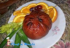 Learn how to cook hamon de bola glazed with honey and pine apple syrup.  To make hamon de bola:...