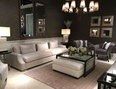 This elegant living room by Dorya combines some of the designs from the popular Contemporary Collection. The Carlo sofa, with its exquisite tailoring and superb comfort, is shown in Titanium finish, stainless steel nail trim and fabrics exclusive to Dorya. The Rome square leather ottoman and movable Perry table offer additional versatility for entertaining.